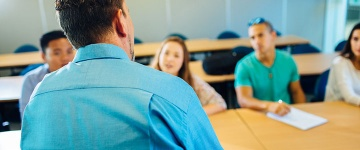 Students engaged with Teacher in class